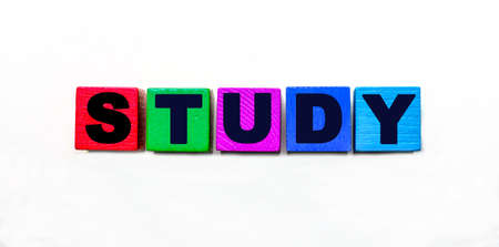 The word STUDY is written on colorful cubes on a light background