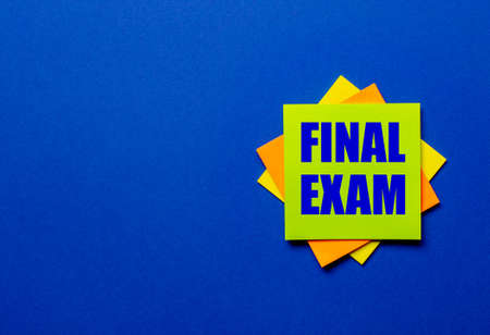 The words FINAL EXAM is written on bright stickers on a blue background