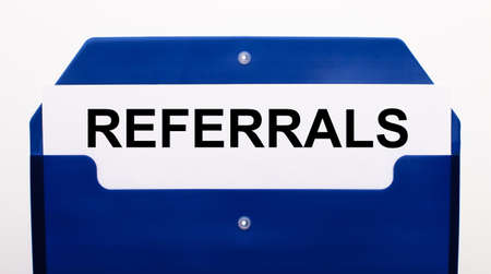On a white background, a blue folder for papers. In the folder is a sheet of paper with the word REFERRALS