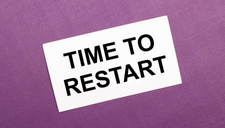 On a lilac background, a white card with the words TIME TO RESTART