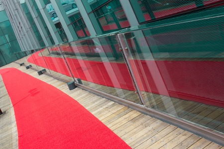Roll out the red carpet of the road and its reflection  photo