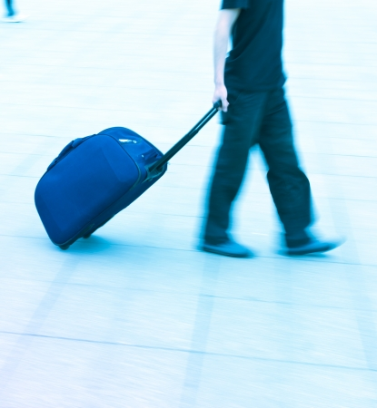 walking passenger in railway station blur motion  photo