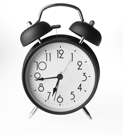 Old-fashioned alarm clock isolated on a white background  photo