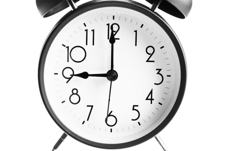 Old-fashioned alarm clock isolated on a white background Stock Photo - 13813010