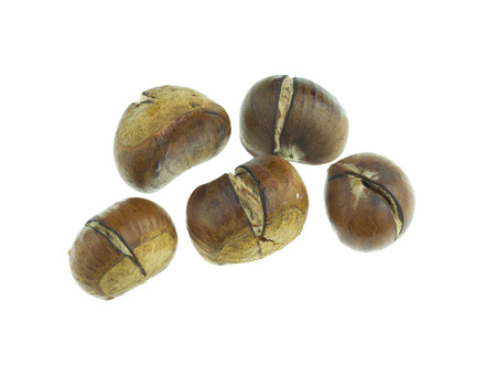 blazed: Roasted chestnuts isolated on white background