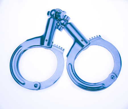 handcuffs: Metallic handcuffs Stock Photo