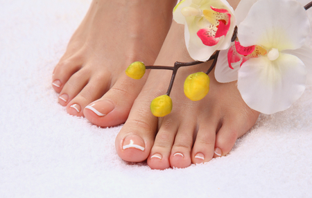 pedicure: Beautiful feet with perfect spa french nail pedicure .