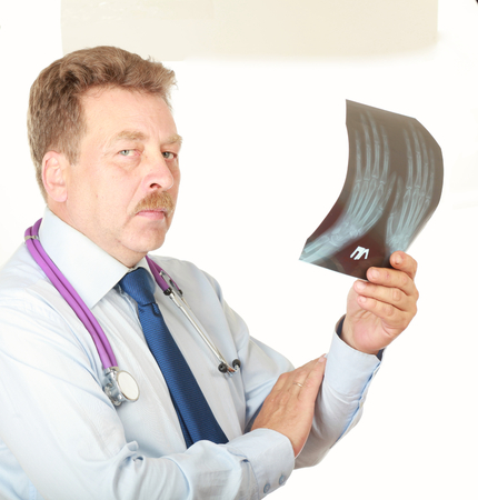 listened: male doctor, close-up portrait,confident holding his stethoscope.