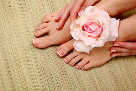 bodypart: Beautiful feet with perfect spa french nail pedicure .