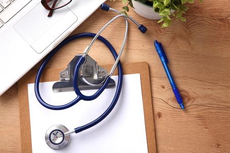 stethoscope: Stethoscope on laptop keyboard. Concept 3D image.