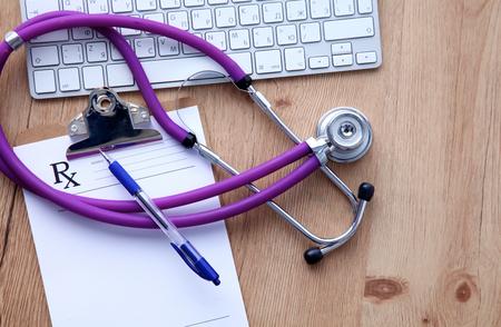 Hospital care: Violet stethoscope on a laptop computer .