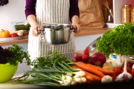cookbook: A young girl in kitchen while cooking. Stock Photo