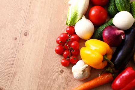 consuming: Composition with assorted raw organic vegetables wooden table. Stock Photo