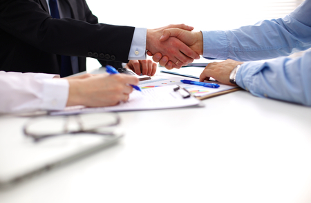 working with hands: Business people shaking hands, finishing up a meeting. Stock Photo