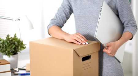 proffesional occupation: a young employee of the office is ready to move. Stock Photo