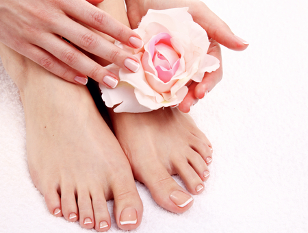 manicure salon: Beautiful feet with perfect spa french nail pedicure .