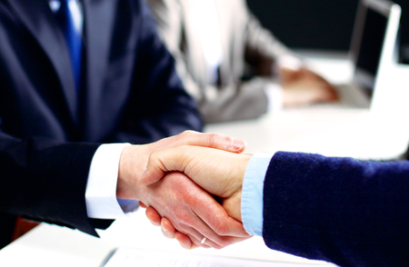 sales person: Business meeting at office. handshake in office. Stock Photo