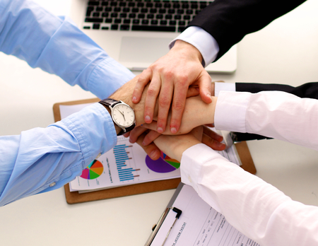 altogether: Business people shaking hands, finishing up a meeting. Stock Photo