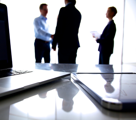 Business meeting at the table shaking hands conclusion of the contract. Reklamní fotografie
