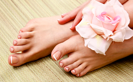 pedicure: pedicure on legs and beautiful manicure on hands closeup.
