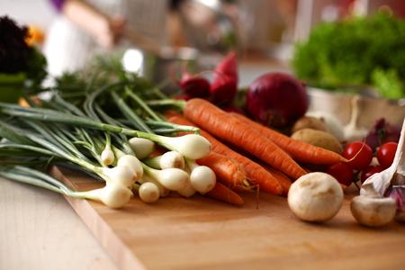 Cook's hands preparing vegetable salad - closeup shot. 写真素材