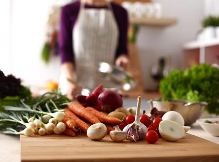 Cook's hands preparing vegetable salad - closeup shot. Archivio Fotografico