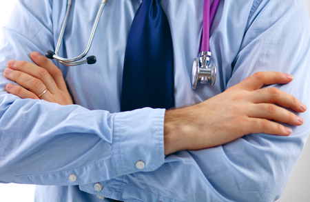listening to heartbeat: Doctor hand holding a stethoscope listening to heartbeat. Stock Photo