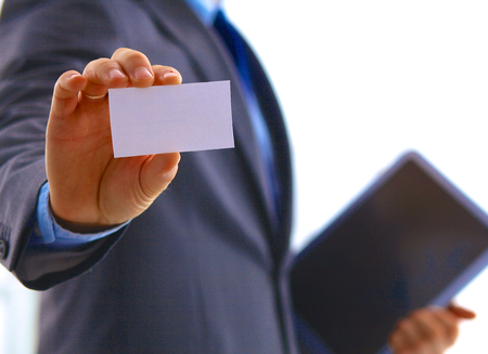 delivers: man businessman with laptop delivers business card.