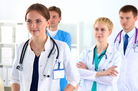 auscultoscope: a team of young doctors in the office.