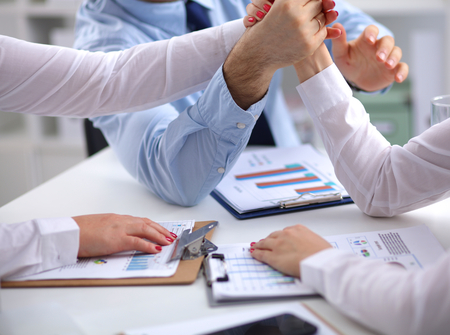 business ideas: Image of business partners discussing documents and ideas at meeting. Stock Photo