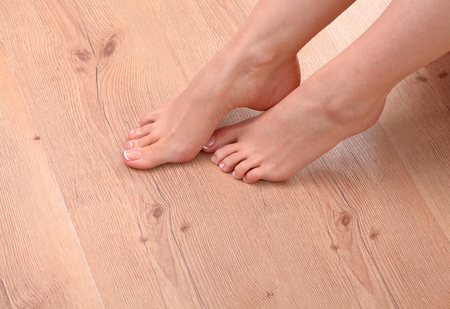 beautiful feet: Closeup photo of a beautiful female feet with red pedicure isolated on white.