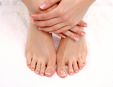 foot cream: Beautiful feet with perfect spa french nail pedicure .