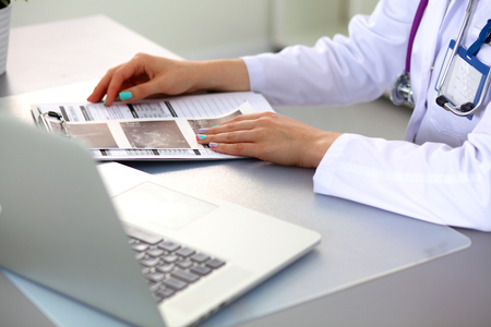 medical clipboard: Portrait of happy medical doctor woman in office. Stock Photo