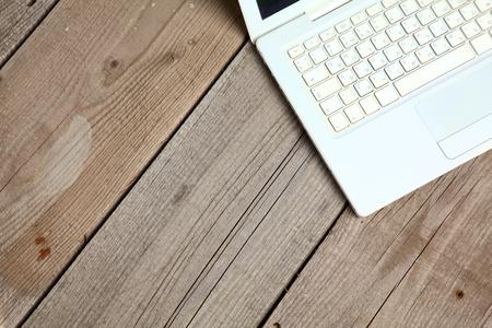 old desk: Notebook and laptop on old wooden desk.
