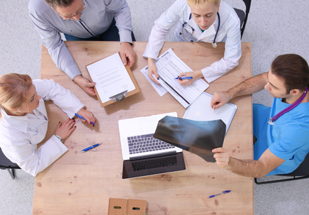 medical professional: Medical team discussing treatment options with patients. Stock Photo