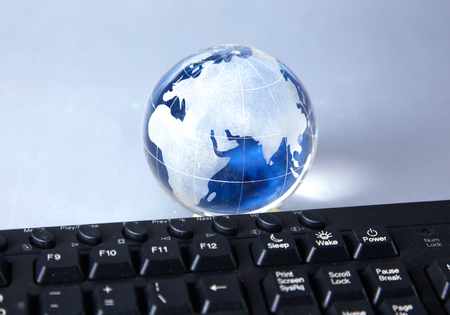 cristal: Cristal globe of the Earth on a Computer. Stock Photo