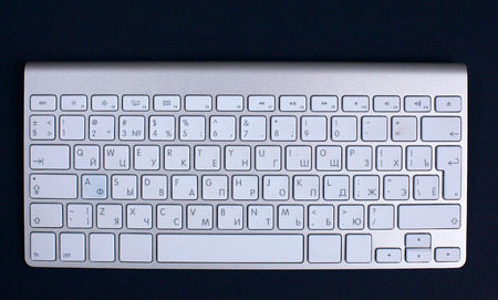 inputting: computer keyboard. Isolated black background. Stock Photo