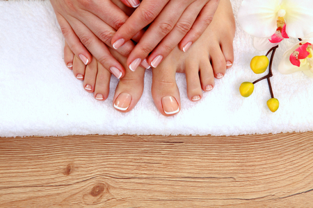 manicure and pedicure: Beautiful feet with perfect spa french nail pedicure .