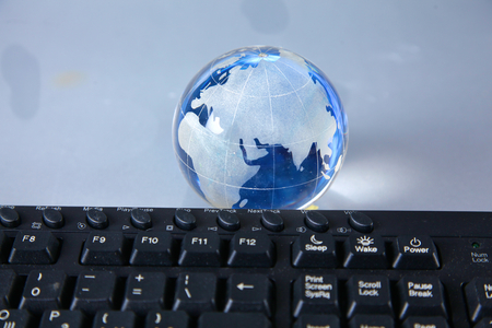compatibility: Cristal globe of the Earth on a Computer. Stock Photo
