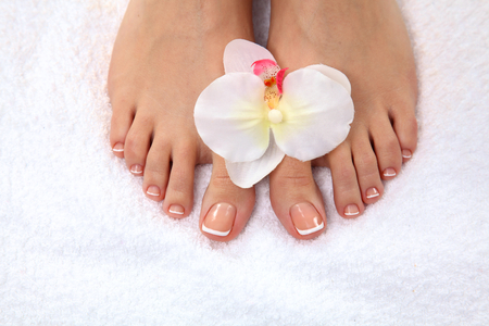 Closeup photo of a beautiful female feet with pedicure.