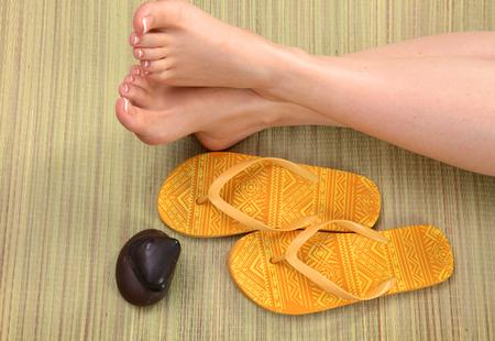 beautiful feet: Closeup photo of a beautiful female feet with pedicure.