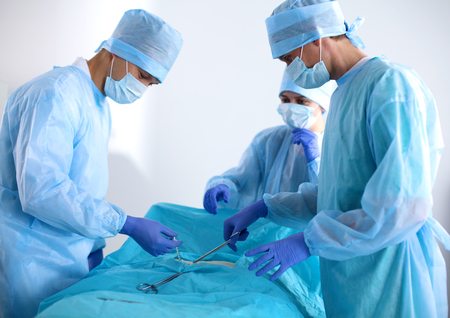 surgery tools: Team of surgeon in uniform perform operation on a patient at cardiac surgery clinic.