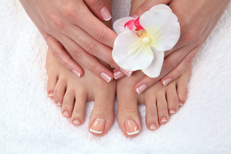 french pedicure: Closeup photo of a beautiful female feet with pedicure.