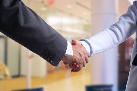 apreton de manos: Business handshake. Two businessman shaking hands with each other in the office.