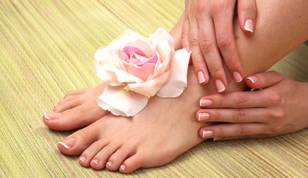 french pedicure: Closeup photo of a beautiful female feet with pedicure.