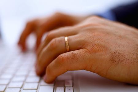 internet surfing: Mans hands typing on laptop. Internet surfing.