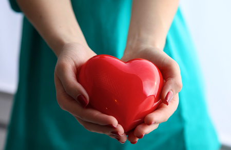 hands holding heart: Health insurance or love concept. Stock Photo