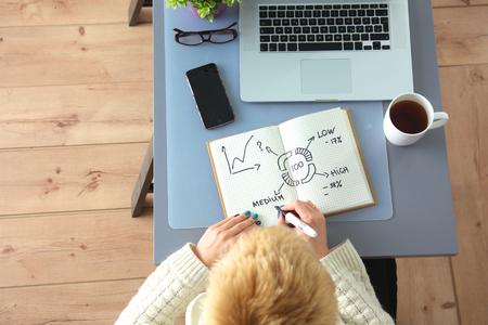 digitizer: Designer working at desk using digitizer in his office. Stock Photo