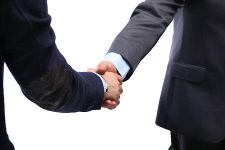 executive: Business handshake. Two businessman shaking hands with each other in the office.