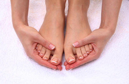 manicure and pedicure: Closeup photo of a beautiful female feet with pedicure.